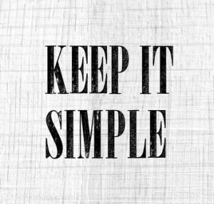 Keep it simple phrase on white vintage wood background