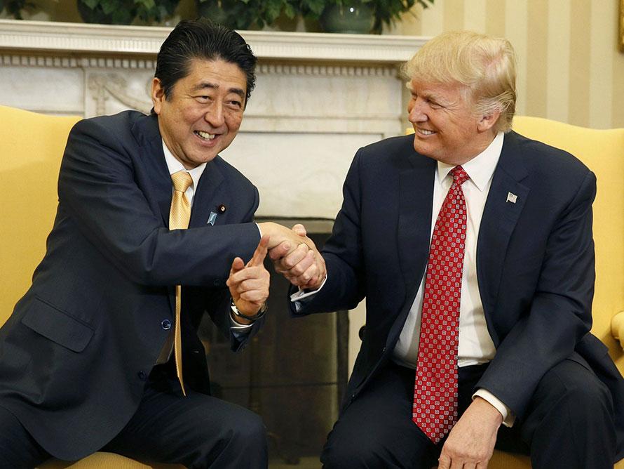 president trump aggressive handshake psychology
